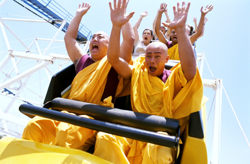 Monks-riding-on-roller-coaster-with-gettyimages